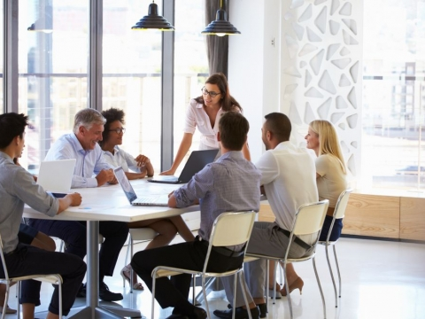 A group of businesspeople around an office table.